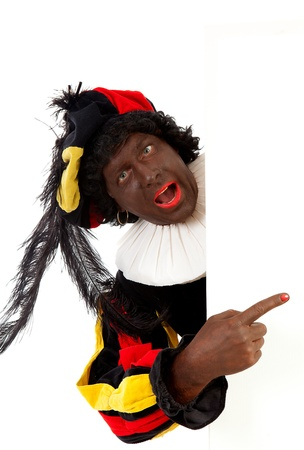 zwarte: Zwarte piet ( black pete) typical Dutch character part of a traditional event celebrating the birthday of Sinterklaas in december over white background with white empty text board Stock Photo