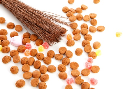 Roe of black Pete ( zwarte Piet) and pepernoten ( ginger nuts) over white background