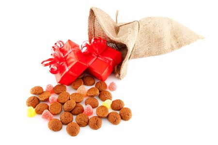 Typical Dutch celebration: Sinterklaas with surprises in bag and ginger nuts, ready for the kids in december. Isolated on white background Stock Photo - 11554706