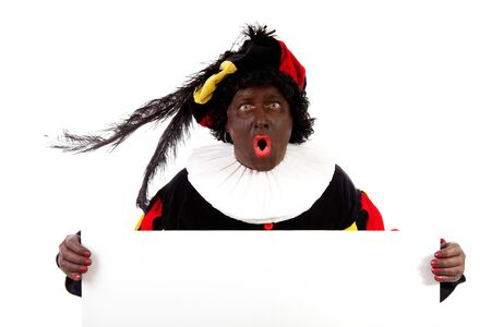 black pete: Zwarte piet ( black pete) typical Dutch character part of a traditional event celebrating the birthday of Sinterklaas in december over white background is holding empty text board