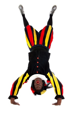 Zwarte piet ( black pete) typical Dutch character part of a traditional event celebrating the birthday of Sinterklaas in december over white background upside down photo
