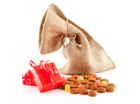 Typical Dutch celebration: Sinterklaas with surprises in bag and ginger nuts, ready for the kids in december. Isolated on white background Stock Photo - 11554732