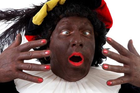 Close-up van grappige Zwarte Piet (Zwarte Piet) typisch Nederlandse karakter deel uit van een traditionele gebeurtenis vieren van de verjaardag van Sinterklaas in december op een witte achtergrond Stockfoto - 11554637