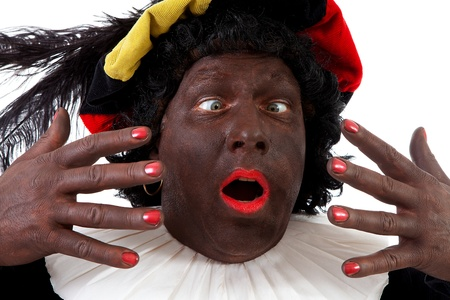 Closeup of funny Zwarte piet ( black pete) typical Dutch character part of a traditional event celebrating the birthday of Sinterklaas in december over white background