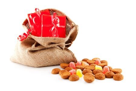 zak: Typical Dutch celebration: Sinterklaas with surprises in bag and ginger nuts, ready for the kids in december. Isolated on white background Stock Photo