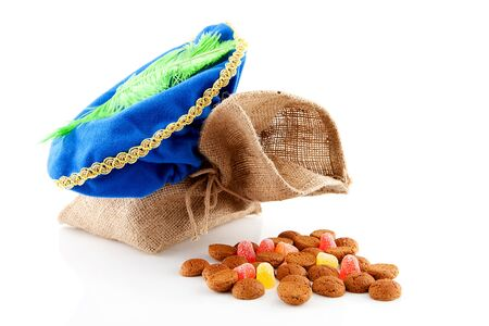 zak: Typical Dutch celebration: Sinterklaas with bag and ginger nuts, ready for the kids in december. Isolated on white background Stock Photo