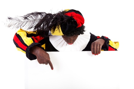advertize: Zwarte piet ( black pete) typical Dutch character part of a traditional event celebrating the birthday of Sinterklaas in december over white background is holding empty text board