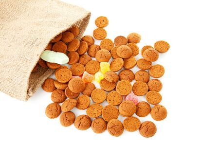 bag with typical dutch sweets: pepernoten (ginger nuts) for a celebration at 5 december in the Netherlands over white background Stock Photo - 11554629