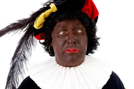 madman: Zwarte piet ( black pete) typical Dutch character part of a traditional event celebrating the birthday of Sinterklaas in december over white background making funny face