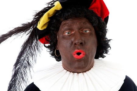 black pete: Zwarte piet ( black pete) typical Dutch character part of a traditional event celebrating the birthday of Sinterklaas in december over white background making funny face