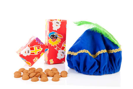 strooigoed: Hat of black pete ( zwarte Piet), gifts and pepernoten ( ginger nuts) for typical Dutch event in december