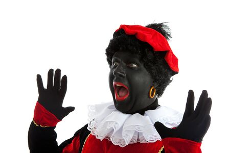Zwarte piet ( black pete) typical Dutch character part of a traditional event celebrating the birthday of Sinterklaas in december over white background is looking surprised photo