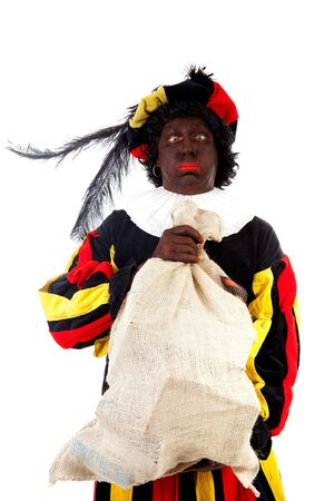 Zwarte piet ( black pete) typical Dutch character part of a traditional event celebrating the birthday of Sinterklaas in december over white background with heavy bag  photo