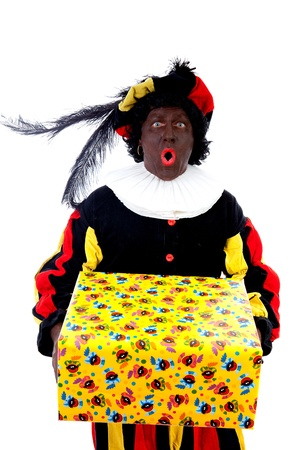 zwarte: Zwarte piet ( black pete) typical Dutch character part of a traditional event celebrating the birthday of Sinterklaas in december over white background with big present