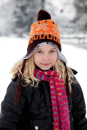 dutch girl: Portrait of Dutch girl in wintertime looking into camera Stock Photo