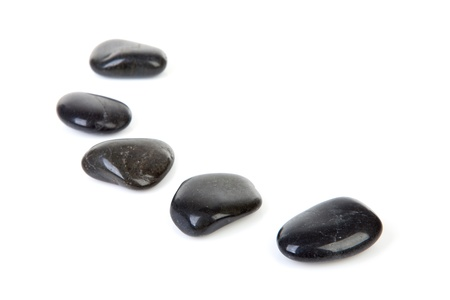 Black stepping stones in a row over white background   photo