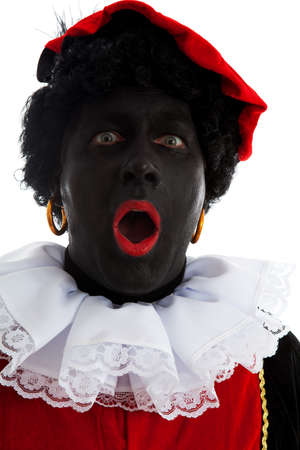 Portrait of surprised Zwarte piet ( black pete) typical Dutch character part of a traditional event celebrating the birthday of Sinterklaas in december over white background Stock Photo - 11720812