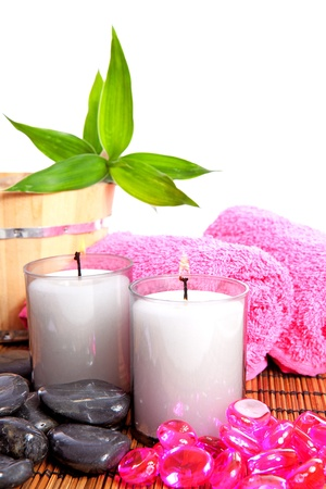 pink spa zen accessories and bamboo on cane mat Stock Photo