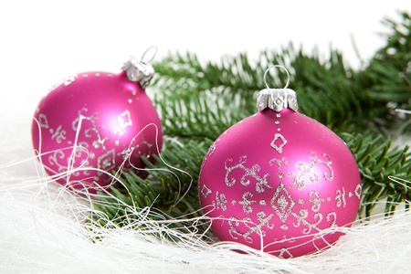 Two pink christmas balls with silver glitters over white background Standard-Bild