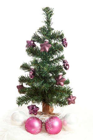 plastic christmas tree with purple stars and pink balls isolated on white background stock photo - White Fake Christmas Tree