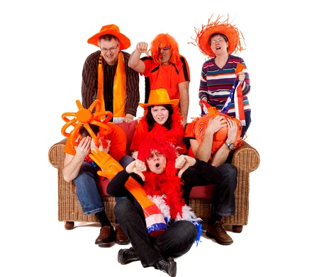 they are watching: Group of Dutch soccer fan watching game and they lost over white background