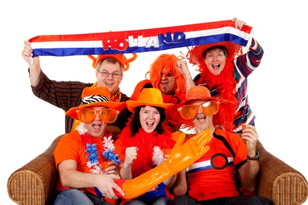 Group of Dutch soccer fan watching game over white background Stock Photo