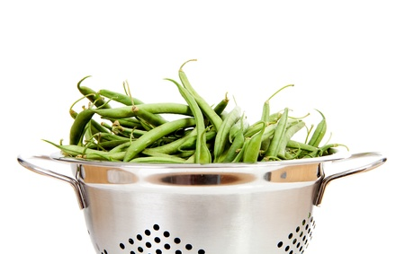 Metal colander with long green beans over white background Stock Photo - 12036522
