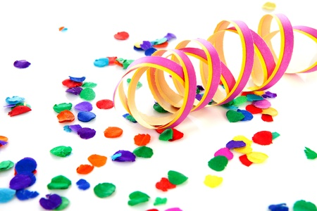 Colorful confetti and party streamer over white background Stock Photo