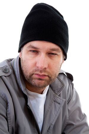 Portrait of male homeless beggar over white background photo