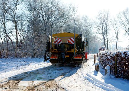 Dutch snow gritter sprinkle salt on the road photo