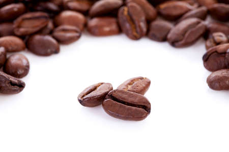 Roasted coffee beans in closeup over white Stock Photo - 12782961