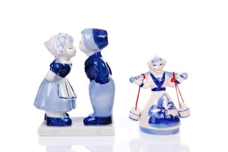 Two Dutch souvenir statues over white background photo