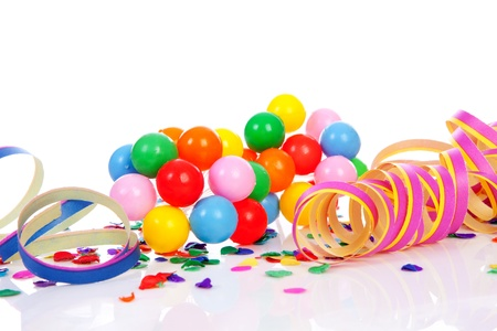 Colorful confetti, balloons and party streamers over white background
