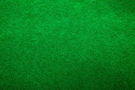 casino table: Background texture of green felt casino table in closeup