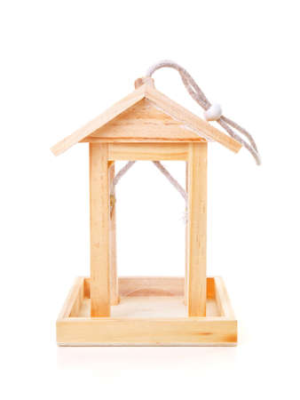 Empty wooden bird feeder house over white background Stock Photo - 12790898