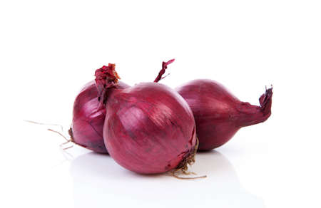 Three red onion isolated on white background Reklamní fotografie