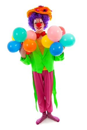 child dressed as colorful funny clown with balloons over white background