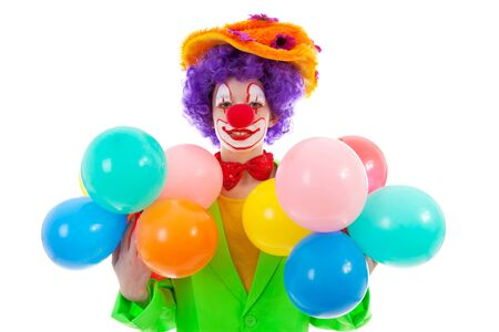 child dressed as colorful funny clown with balloons over white background photo