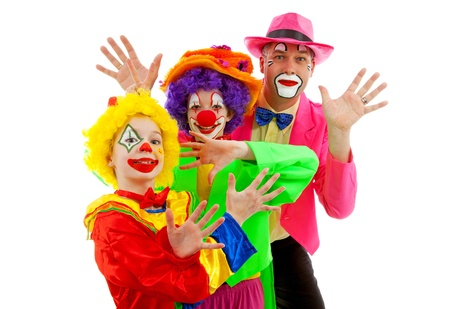 clowns: Three people dressed up as colorful funny clowns over white background Stock Photo