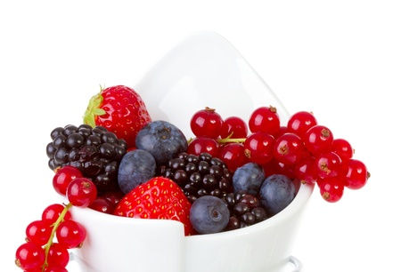 healthy snacks: French fries bag filled with fresh fruit like healthy snack over white background