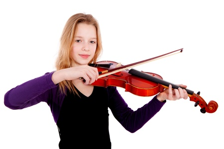 Girl is playing the violin over white background photo