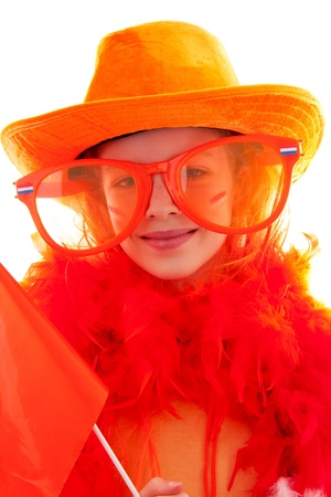 Girl is posing in orange outfit for soccer game or Dutch queensday over white background photo