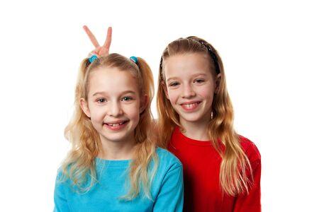 heaving: Two girls heaving fun in studio over white background