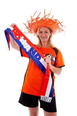Dutch female soccer supporter in orange outfit holding scarf ready for the match over white background photo