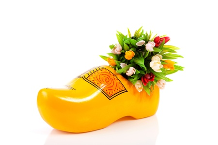 Typical Dutch clog and plastic tulips over white background Stock Photo - 13304867