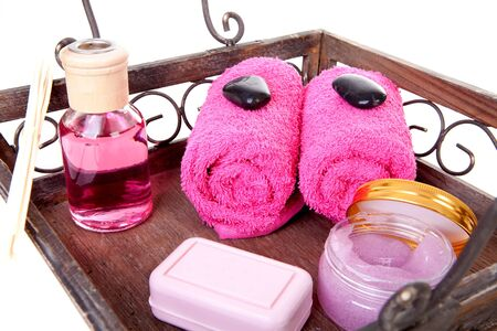 pebles: Pink spa accessories on tray over white background