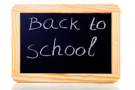 back to school written on blackboard slate over white background photo
