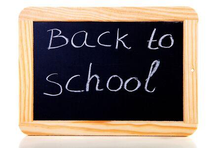 back to school written on blackboard slate over white background photo