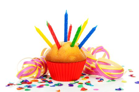 birthday cupcakes: Birthday cupcake with lots of candles, party streamers and colorful confetti over white background