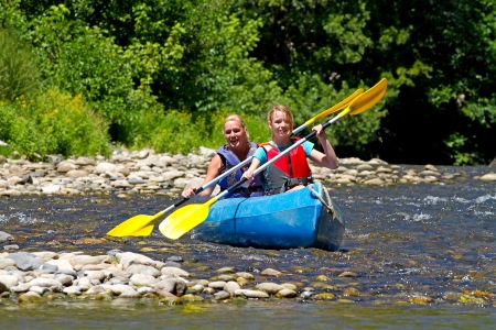 Two people in canoe enjoying holidays and nice weather in the Ardeche Stock Photo